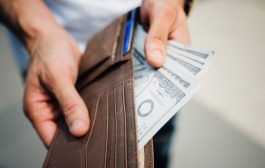 Man Holding Brown Leather Bi-fold Wallet With Money in It
